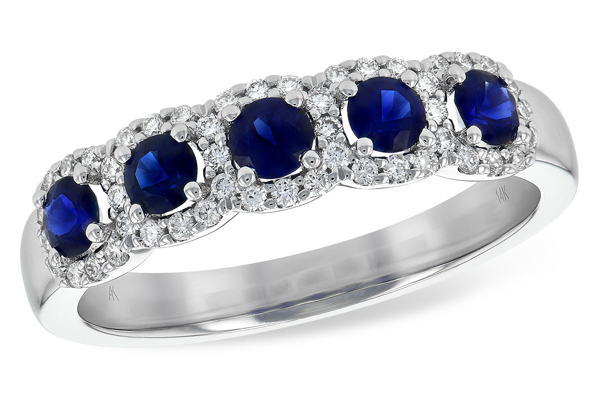 5 round sapphire ring with each sapphire surrounded by halo of 50 round accenting G color, SI1/SI2 clarity diamonds totaling .20ct, 14k white gold, sapphire storaling .58ct