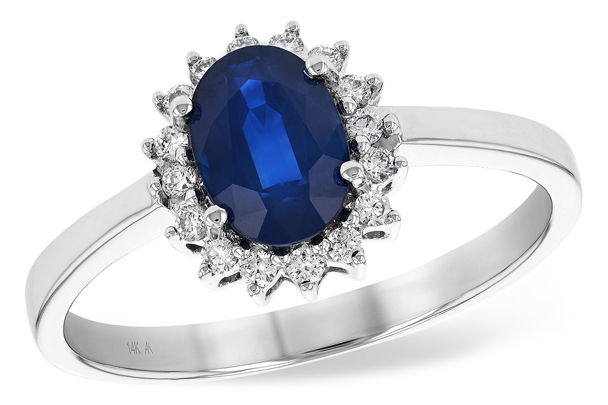 Oval Sapphire ring with .83ct Oval Sapphire surrounded by round accenting G SI1/ SI2 diamonds totaling .14ct, 14k white gold