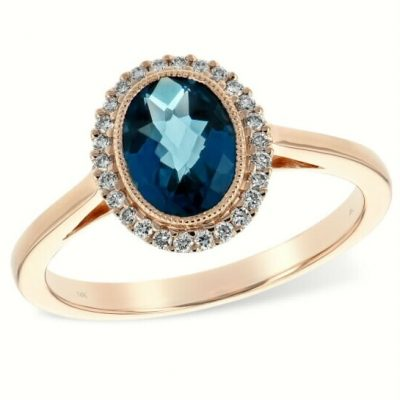 Rose gold Ring with London Blue Topaz Oval with a Halo of Diamonds and Vintage Accent