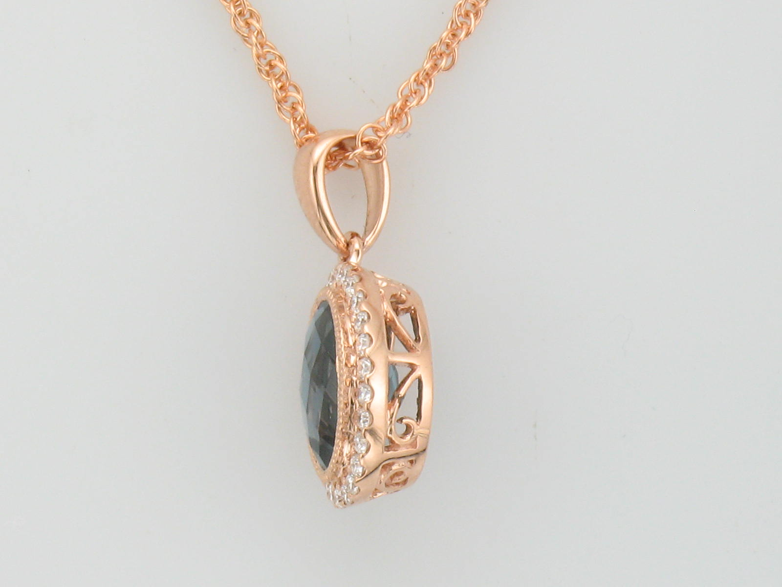 side view Rose gold Pendant with London Blue Topaz Oval with a Halo of Diamonds and Vintage Accent