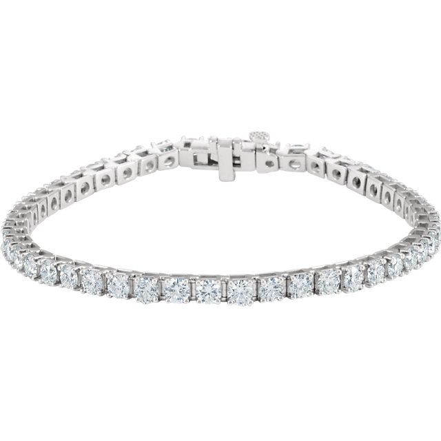 7ct total Diamond Line Bracelet set with 47 Diamonds I1 clarity, G-H color 14k gold weight 13.31 grams 7.25 inch length