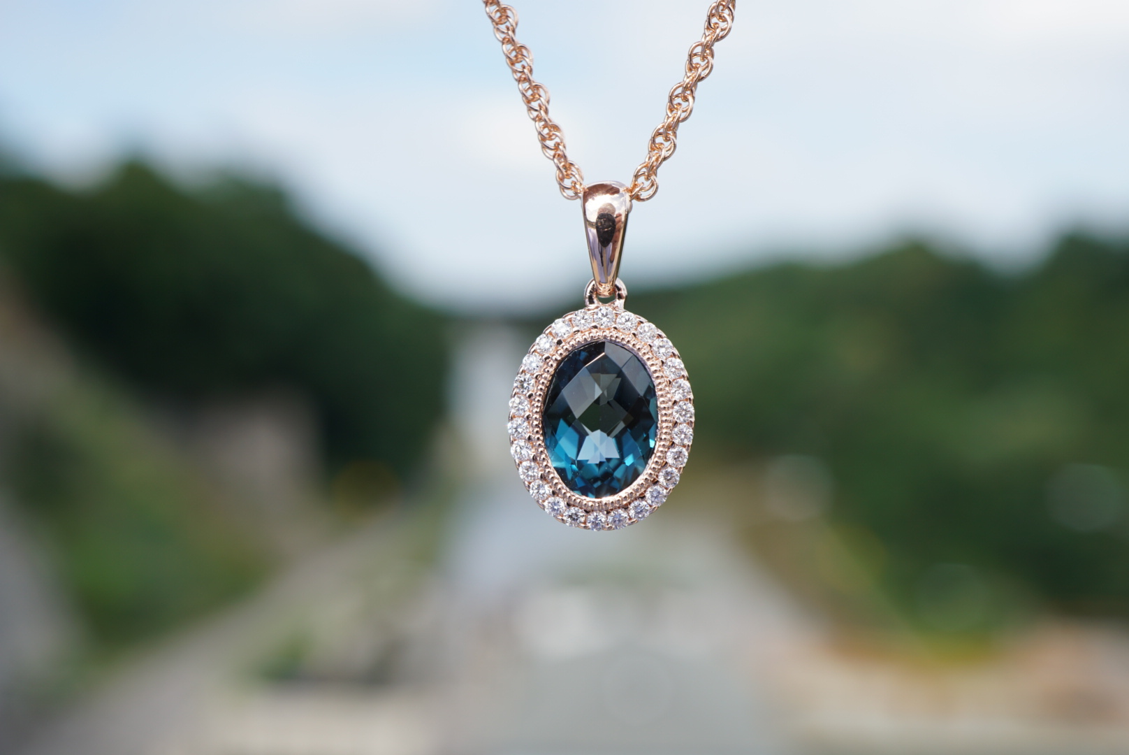 London blue topaz halo pendant rose white or yellow mills jewelers rose gold pendant with london blue topaz oval with a halo of diamonds and vintage accent mozeypictures Gallery