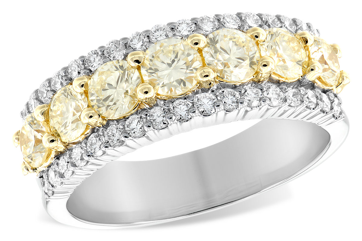 Fancy Yellow Diamond ring with 7 round fancy yellow diamonds set in row of 14k yellow gold and round accenting GH SI2 diamond set along the sides in 14k white gold totaling 1.64ct