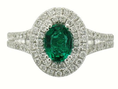 Oval .63ct Emerald ring with double row of GH SI2 round diamonds surrounding the emerald and double row of diamonds down the band all totaling .62ct