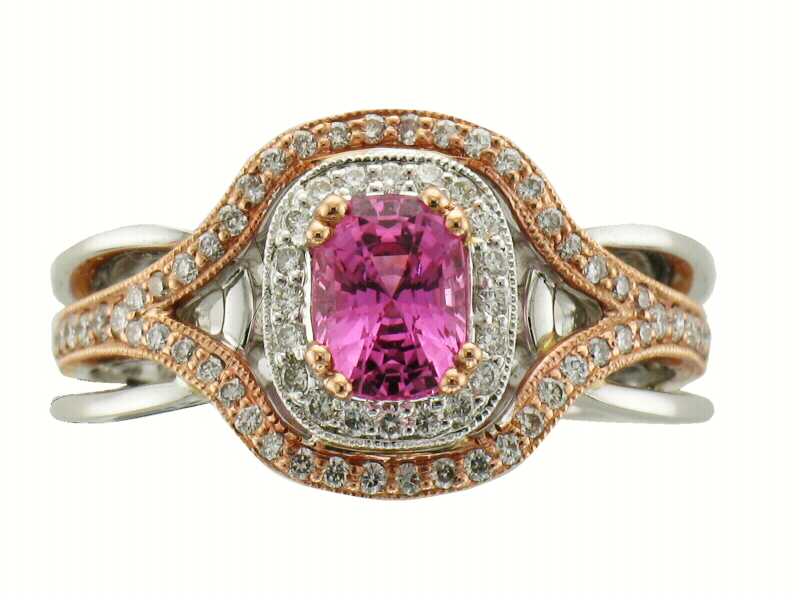 Oval 1.10ct Pink sapphire ring with round accenting diamonds totaling .44ct surrounding the oval and down the band, 14k rose and white gold