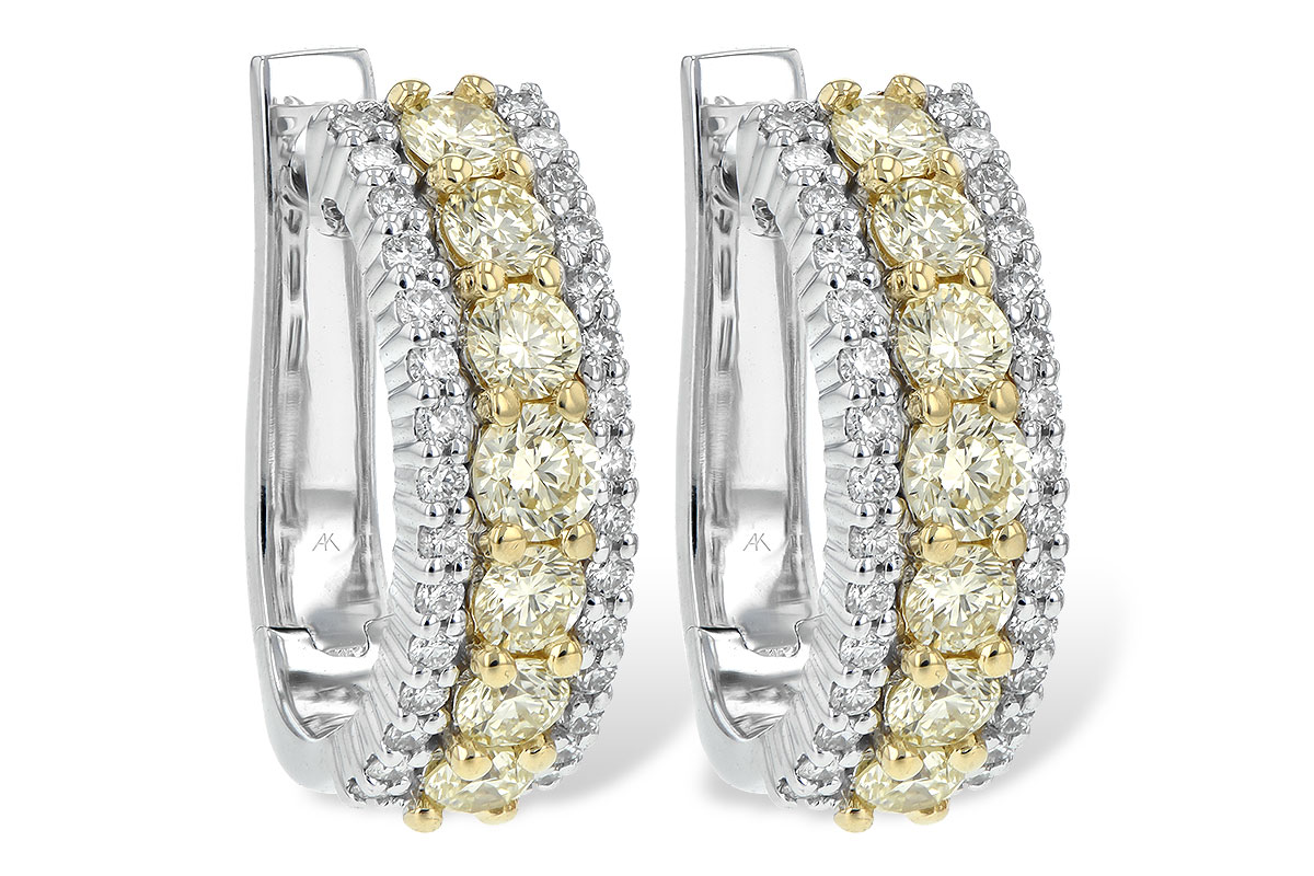 Hoop Earrings with round natural yellow diamonds set down the center in 14k yellow gold totaling 1.15ct and row of G SI1/SI2 round accenting diamonds set down each side in 14k