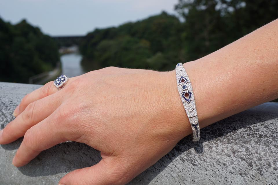 on hand by the Erie Canal Vintage style bracelet with 1.24ct Blue Sapphires set throughout and 1.76ct Round accenting G SI3 diamonds set throughout, tongue and groove clasp, all 14k white gold