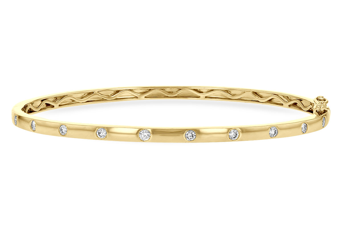 Bangle style 14k yellow gold bracelet with 10 round diamonds spaced out along top of bracelet all bezel set into bracelet, diamonds totaling .40ct, G SI3