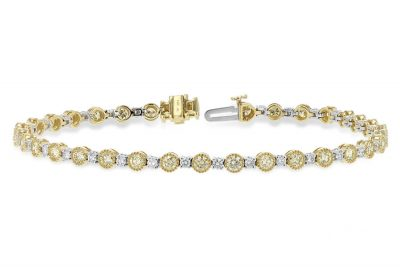 This breathtaking diamond line bracelet feature natural yellow diamonds framed in 14k yellow gold millgrain lined bezel links alternating with brillinat white diamonds. Total Diamond weight is 3.04 carat consisting of 2.22ct total yellow diamonds and .82ct total white diamonds.