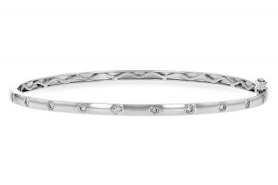 Bangle style 14k White gold bracelet satin finish with 10 brilliant round diamonds spaced out along top of bracelet set flush into bracelet, diamonds totaling .40ct, G color SI3 clarity Opens with a hinge and a safety latch.