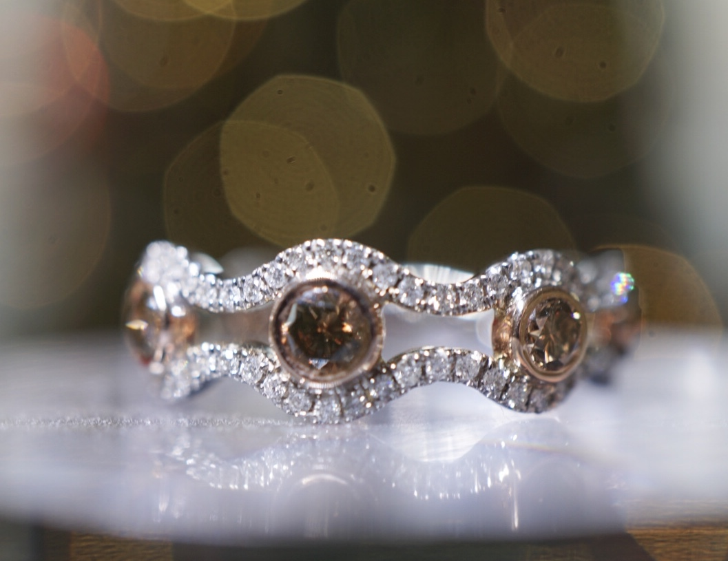 7 Brown Diamonds ring white diamond border