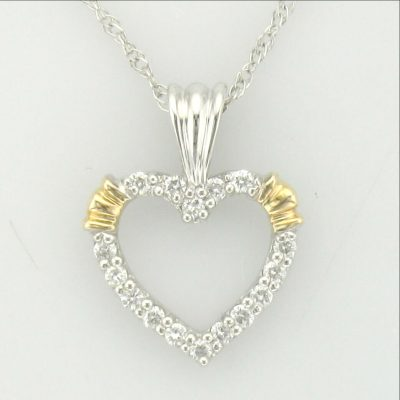 Open Heart Diamond Lined pendant, 16 round GH SI2 accenting diamonds totaling .16ct set into 14k white gold with 14k yellow gold accenting design on 18 inch light rope 14k white gold chain with spring ring clasp