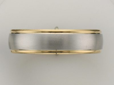 Platinum and 18k Yellow Gold 5.8mm wedding band with satin finish platinum center