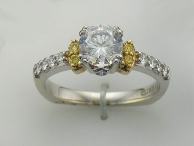 18k Two Tone A. Jaffe Signature Collection Semi Mount Engagement Ring with 4 Round Natural Yellow diamonds on sides of center and row of 4 G Color, VS2 Clarity round accenting diamonds set down each side of band with bezel set profile accenting diamond in center head-al diamonds totaling .33ct, 1.0ct CZ Center