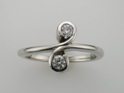 Two stone 14k white gold diamond ring, diamonds totaling .25ct GH SI3, diamonds set in 's' curve bezel