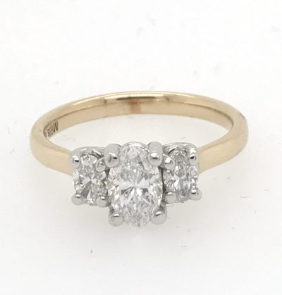 3 Diamond Ring, Center Oval .81 carat D color with matched pair of oval diamonds