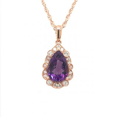 Pear shape 1.53ct Amethyst Pendant with round diamonds surrounding the amethyst set in milgrain edging, all diamonds totaling .15ct, 14k rose gold, 18 inch rope chain with lobster clasp