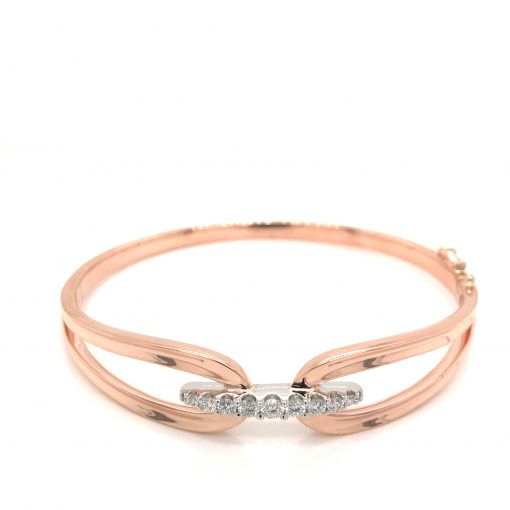 Bangle style bracelet, belt buckle style, 14 rose gold with row of round accenting diamonds totaling .50ct across the center set into 14k white gold, GH Color, SI2 Clarity