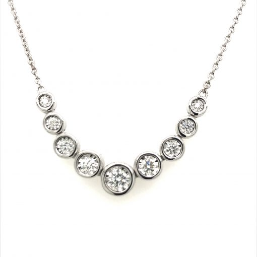 9 Bezel style Diamonds stationed in the center of 14k white gold cable chain necklace 18 inch with lobster clasp, .50 carat, G Color SI3 clarity 14k white gold From the Champagne Bubbles Collection