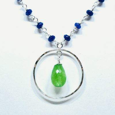 16-18 inch adjustable necklace with Dyed Green jade teardrop in center of open sterling silver circle and chain of dyed navy blue jade stones