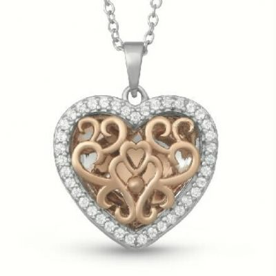 14k Rose gold Mary heart locket with filigree center and white gold outside lined with accenting white topaz, 16-18 inches
