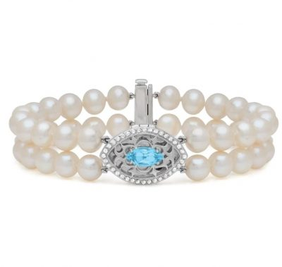 Sadie With You Locket Bracelet with double strand of freshwater pearls and marquise shape filigree locket in the center and marquise sky blue topaz set in the middle and accenting white toaps surrounding the outside of locket, sterling silver