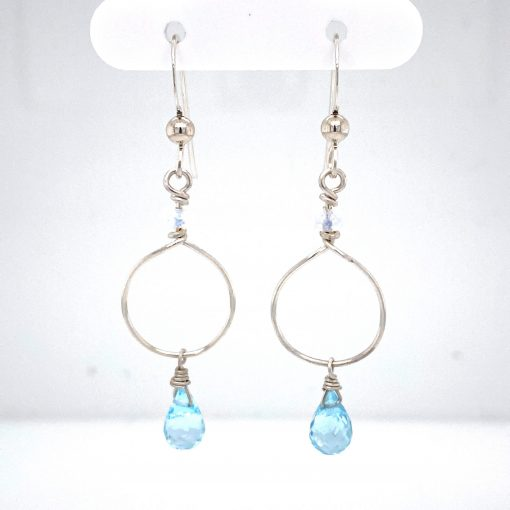 5x7mm Blue Topaz Briolette Drop below open teardrop of silver and 4mm faceted moonstone above on Sterling silver eurowire