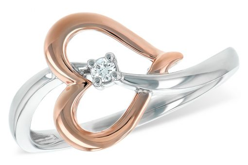 This ring features a graceful curved 14k white gold band that flows through an open heart of blushing 14k rose gold. The heart is angled in a free-form style with a round brilliant accenting center diamond. The diamond weighs .03 carat, G-H color grade and SI2 clarity grade.