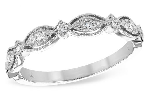 14k White Gold Vintage style wedding ring, anniversary ring, or stackable fashion ring. This ring features plenty of milgrain beaded borders conjuring the age of romance. Each of the 9 alternating sections of marquise and diamond shaped settings feature a brilliant round accenting diamond with a bright white color grade of G and a clarity grade of SI1. Total diamond carat weight is .15ct.