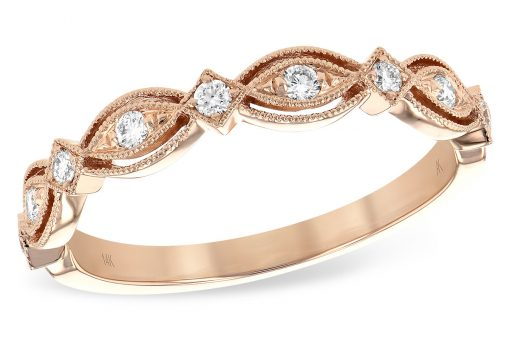 14k Rose Gold Vintage style wedding ring, anniversary ring, or stackable fashion ring. This ring features plenty of milgrain beaded borders conjuring the age of romance. Each of the 9 alternating sections of marquise and diamond shaped settings feature a brilliant round accenting diamond with a bright white color grade of G and a clarity grade of SI1. Total diamond carat weight is .15ct.