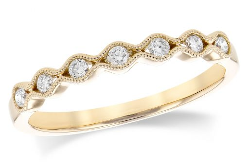 14k Yellow Gold Scalloped pattern band with a subtle vintage theme featuring 7 round brilliant cut diamonds. Each individual diamond is hugged tightly in a channel of 14k gold with a millgrain beaded border. Diamonds are G-H Color grade and SI2 Clarity grade .17 carat.