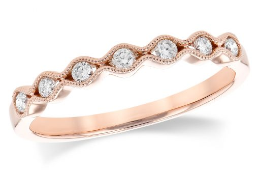 14k Rose Gold Scalloped pattern band with a subtle vintage theme featuring 7 round brilliant cut diamonds. Each individual diamond is hugged tightly in a channel of 14k gold with a millgrain beaded border. Diamonds are G-H Color grade and SI2 Clarity grade .17 carat.