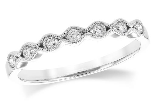 14k White Gold Scalloped pattern band with a subtle vintage theme featuring 7 round brilliant cut diamonds. Each individual diamond is hugged tightly in a channel of 14k gold with a millgrain beaded border. Diamonds are G-H Color grade and SI2 Clarity grade .17 carat.