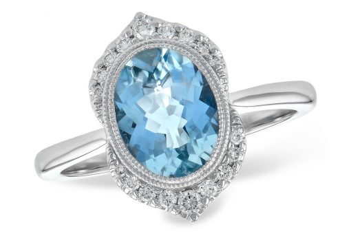 Dive into this calming blue oval shaped Aquamarine weighing 1.56 carat. The center gem is bezel set in 14k white gold with milgrain beaded edging for a hint of vintage styling. It's framed in brilliant white diamonds that come to a point at the top and bottom of gem. The diamonds total .14ct and are a bright white G color grade and SI1/SI2 clarity grade.
