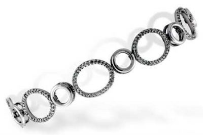 This spectacular bracelet features open circles alternating with oval shapes lined with brilliant round accenting diamonds, bright white G-H Color grade and superior SI2 clarity grade. Diamonds total 1.14 carat. The bracelet measures 7 inches in length, Well constructed in the USA for durability in 14k white gold