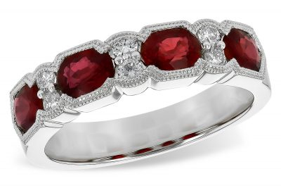 14k White gold ring featuring large dramatic oval rubies in a vintage style band accenting with 6 brilliant cut diamonds. Total ruby weight is 1.66ct and 2 accenting diamonds set between each - 6 diamonds total - diamonds totaling .18ct, Total Gem weight is 1.84 carat. Beaded milgrain edging borders all gems.