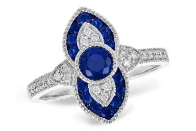 Vintage style sapphire and diamond ring with round accenting sapphires and 4.7mm center round sapphire all totaling .63ct, accenting diamonds totaling .12ct 14k white gold, milgrain edging