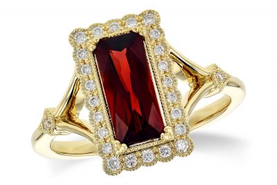 14k Yellow Gold Rectangular Radiant Cut Mozambique garnet ring with 1.60 garnet in the center with round accenting diamonds surrounding the garnet all bezel set with milgrain beading, all diamonds totaling .17 carat total diamonds, G-H Color, SI2 clarity
