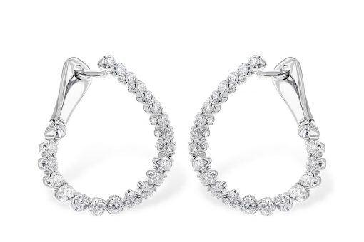 Hoop earrings with round brilliant cut diamonds set up the front and showing up the front of the back, giving the illusion of diamonds inside and out. All diamonds total .50 carat wit a bright white G Color grade and an SI3 Clarity grade in 14k white gold