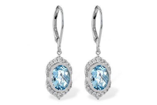 Oval drop earnings with bezel set a captivating checker-board cut Aquamarine in a icy-cold powder blue color. The gems are framed with milgrain edging giving the earrings a touch of vintage styling.  The base of the design comes to a graceful point accented with a larger diamond. Diamonds halo the top and bottom of gems. Aquamarines total 2.24 carat and the diamonds total .19 carat with a bright white color grade of G and a superior clarity grade of SI1/SI2