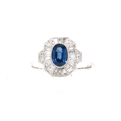 Vintage style ring with oval .65ct blue sapphire bezel set into the center and tapered and round diamonds surrounding the sapphire in a rectangle shape, diamonds all GH SI2 and totaling .25ct, 14k white gold