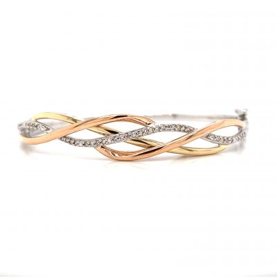 Sterling Silver Bangle Bracelet with interlocking braided ribbons of 10 karat rose gold, sterling silver and a center ribbon of brilliant round diamonds total .20 carat.