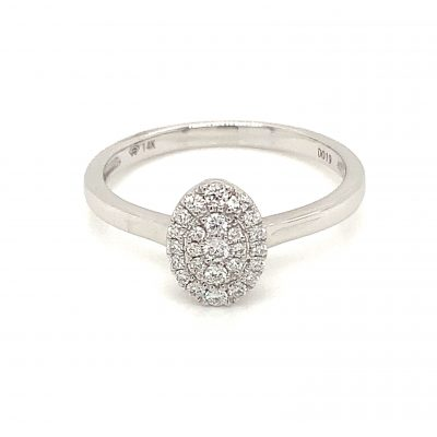 Oval Cluster diamond ring with round accenting pave set diamonds all totaling .20ct, GH Color, SI2 Clarity, 14k white gold