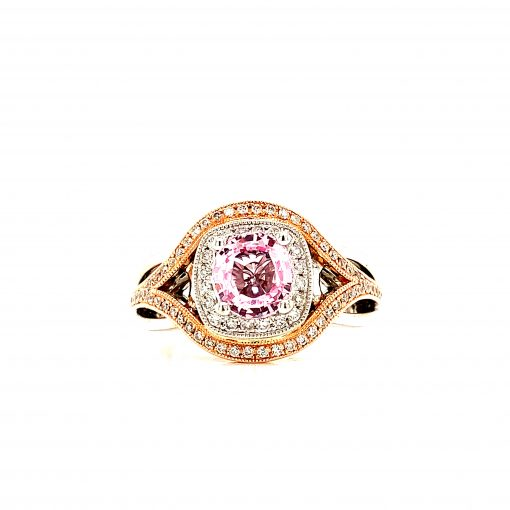 2 tone ring with 1.36ct Pink sapphire in the center and round accenting diamonds surrounding the sapphire and down the split band, 14k white and rose gold, all diamonds GH SI2 totaling .33ct
