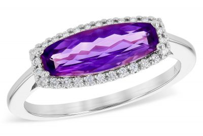 Horizontally set elongated cushion shaped Amethyst ring with halo of brilliant white diamonds surrounding the amethyst. Diamonds total .11 carat, G-H color grade, SI2 clarity grade, 14k white gold