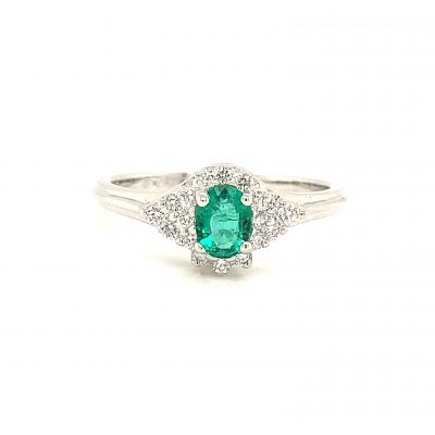 Oval 6x4mm Emerald ring with round diamonds surrounding the emerald and on 3 on each side of center oval of diamonds, all diamonds totaling .20ct, GH SI2, 14k white gold