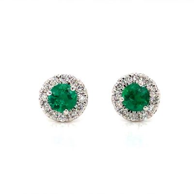 Round Emerald post earrings with round accenting diamonds surrounding the emerald, all diamonds totaling .19ct, all 14k white gold