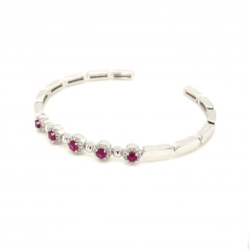 Bangle cuff Style bracelet with 5 round rubies each surrounded by halo of round accenting diamonds, rubies all totaling .63ct, all diamonds GH Color, SI2 Clarity and totaling .19ct, 14k white gol