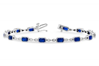 Sapphire and Diamond bracelet with 14 oval sapphires set into rectangular bezel set links and infinity link between each with 2 GH SI1 diamonds per infinity, all milgrain edging, 14k white gold, diamonds totaling .32ct, sapphires totaling 4ct