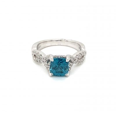 Cushion Shape Blue Zircon ring with inifinity inspired band lined with round accenting diamonds totaling .32ct, GH Color SI2 Clarity, 14k white gold